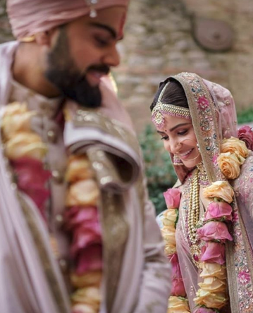 Virat Kohli & Anushka shared few wedding moments on the first Anniversary.