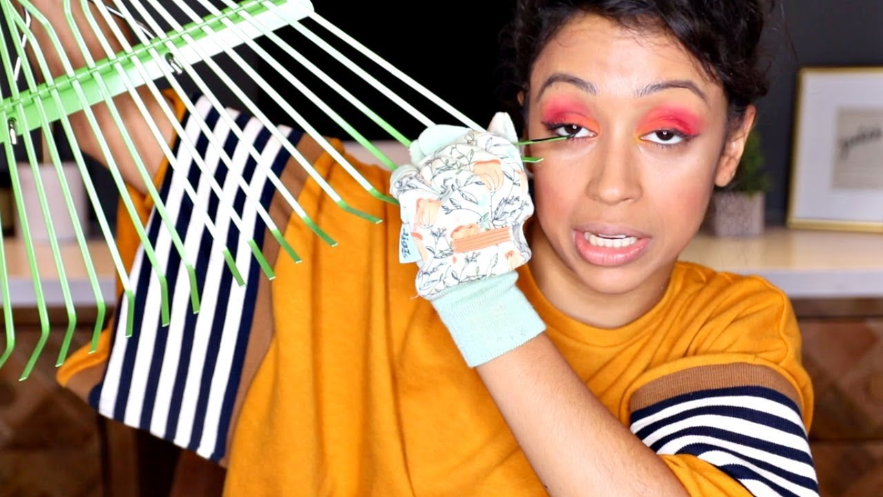 LIZA KOSHY DID MAKE UP WITH HER GARDENING TOOLS.